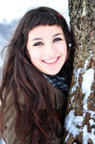 Beautiful woman smiling in winter time. Close-up portrait of a beautiful young woman smiling outside in winter time Royalty Free Stock Photo