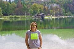 Beautiful Woman is smling at camera at Lake Bohinj,Slovenia Royalty Free Stock Images