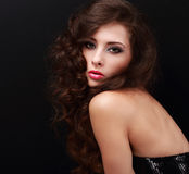 Beautiful woman with smokey eyes bright makeup and long curly hair Royalty Free Stock Image