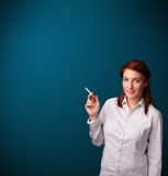 Beautiful woman smoking cigarette vith copy space Royalty Free Stock Photo