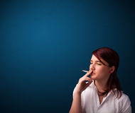 Beautiful woman smoking cigarette vith copy space Royalty Free Stock Photo