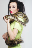 Beautiful woman with a snake Royalty Free Stock Photography