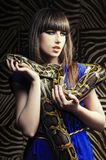 Beautiful woman with a snake Royalty Free Stock Image