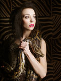 Beautiful woman with a snake Royalty Free Stock Photos