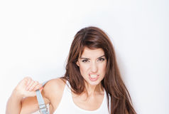 Beautiful woman with snarling expression Stock Images