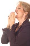 Beautiful woman sneezing. Photo of a beautiful woman sneezing Royalty Free Stock Photo