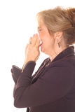 Woman sneezing side Stock Photography