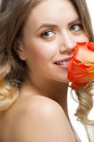 Beautiful woman sniffing rose Royalty Free Stock Photos