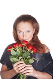 Beautiful woman smelling roses Royalty Free Stock Photography