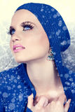 Beautiful woman in snow. Beautiful woman in blue jacket and snow falling around her Royalty Free Stock Photos