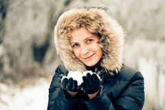 Beautiful woman with snow in her hands Royalty Free Stock Image