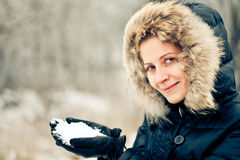 Beautiful woman with snow in her hands Royalty Free Stock Images