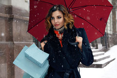 Beautiful woman snow street buy presents Christmas New Year Royalty Free Stock Images