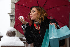 Beautiful woman snow street buy presents Christmas New Year Stock Photo