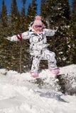 Beautiful woman on the snowboard Stock Photos