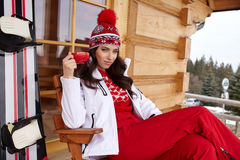Beautiful woman with a snowboard Stock Images