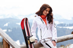 Beautiful woman with a snowboard Royalty Free Stock Image