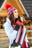 Beautiful woman with a snowboard Royalty Free Stock Photo