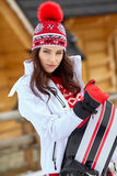 Beautiful woman with a snowboard Royalty Free Stock Photos