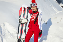Beautiful woman with a snowboard. Sport concept royalty free stock image