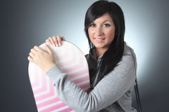 Beautiful woman with a snowboard in studio Royalty Free Stock Images