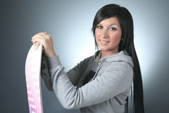 Beautiful woman with a snowboard in studio Stock Photos
