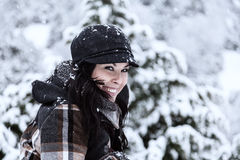 Beautiful Woman in a Snowy Day Royalty Free Stock Photos