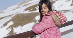 Beautiful woman in snowy mountains Stock Photo