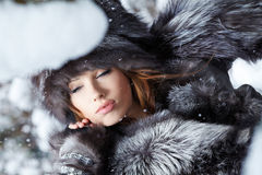 Beautiful woman in snowy winter outdoors Stock Photography