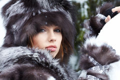 Beautiful woman in snowy winter outdoors Royalty Free Stock Photo