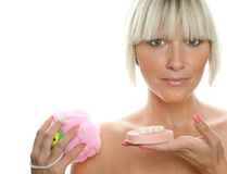 Beautiful woman with soap and sponge Royalty Free Stock Photo