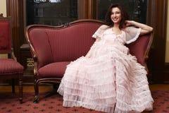 Beautiful woman on sofa Stock Photography