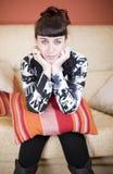 Beautiful woman in a sofa Stock Photo