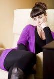 Beautiful woman in a sofa Stock Photography
