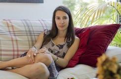 Beautiful woman on sofa Stock Photos