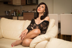 Beautiful woman on the sofa Stock Photography