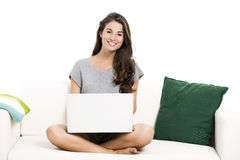 Working with a laptop at home Royalty Free Stock Photography