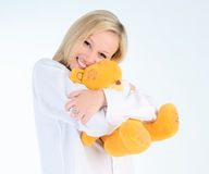 A beautiful woman with soft toy in his hands. Royalty Free Stock Images