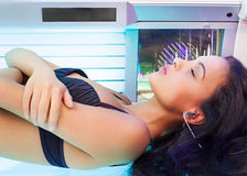 Beautiful woman in solarium royalty free stock images