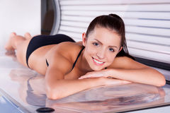 Beautiful woman in solarium. Stock Image