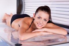 Beautiful woman in solarium. Stock Image
