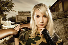 Beautiful woman soldier. With a sniper rifle royalty free stock photo