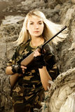 Beautiful woman soldier. With a sniper rifle stock photo