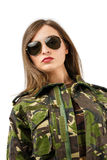 A beautiful woman soldier with camouflage uniform an Stock Photography