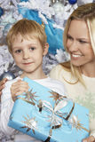Beautiful Woman With Son Holding Christmas Present Royalty Free Stock Image