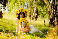 Beautiful woman with son sitting down Royalty Free Stock Images