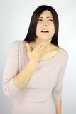 Beautiful woman with sore throat ill royalty free stock image