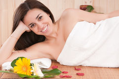 Beautiful woman in spa center having relax. Smiling stock photography