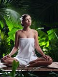 Beautiful woman in spa environment. stock photography