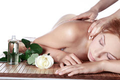 Beautiful woman at spa with flower Stock Photography